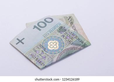 Polish Zloty banknotes (PLN) close up isolated on white background. Polish One Hundred Zlotych