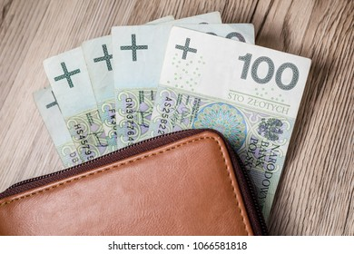 Polish Zloty banknotes (PLN) closeup. Polish One Hundred Zlotych in brown wallet