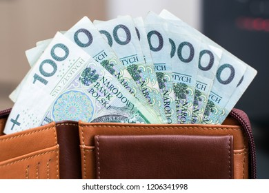Polish Zloty banknotes (PLN) closeup. Polish One Hundreds Zlotych in brown wallet.