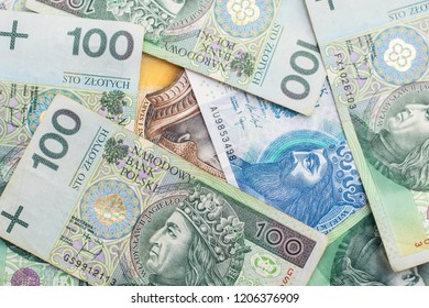 Polish Zloty banknotes (PLN) closeup, background. Polish One Hundred Zlotych, two hundred and fifty Zlotych.
