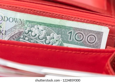 Polish Zloty banknotes (PLN) closeup. Polish One Hundred Zlotych in red wallet