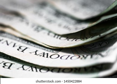 Polish Zloty banknotes (PLN) composition - Closeup on stack 100 PLN banknotes. Macro shot. Business background