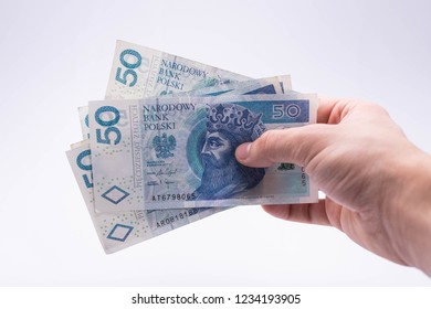 A lot of Polish Zloty banknotes (PLN) in human hand.