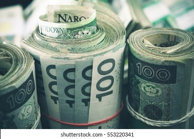 Polish Zloty Cash Rolls. One Hundred Polish Zloty Rolled Banknotes.