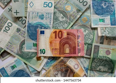 Polish Zloty and Euro banknotes. Stack of polish and euro money. Business and financial concept. Euro money in Poland