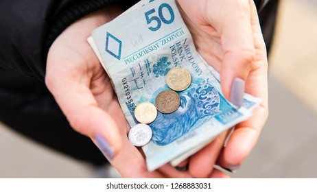 Polish zloty in female hands. Prices for tourism in Poland