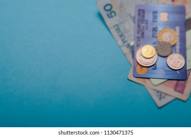 Polish zloty in notes and coins on blue background