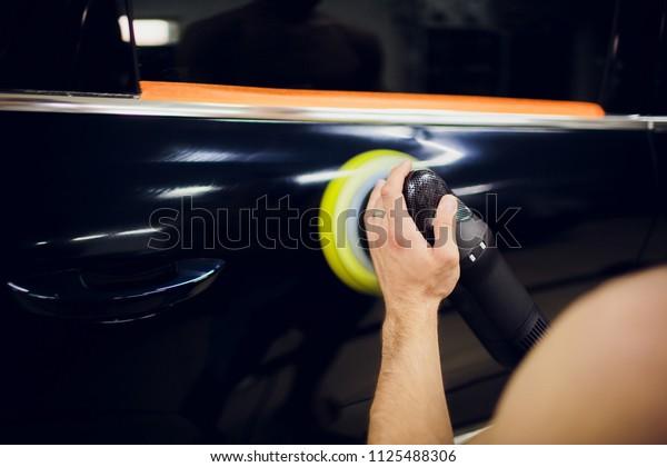 Polished black car polishing machine polished finishing. Car detailing. Selective focus.