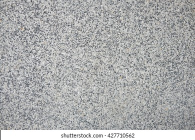Polished granite texture in whites, grays and blacks