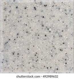 Polished gray granite texture with black and white inclusions. Stone surface background