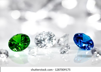 Polished jewels, diamond, blue sapphire and green emerald, flawless brilliant cut