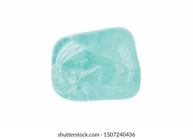 Polished pebbles of aquamarine gemstone (blue variety of beryl - beryllium ore) isolated on a white background