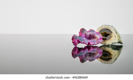 Polished rocks, crystal, geode - purple and yellows