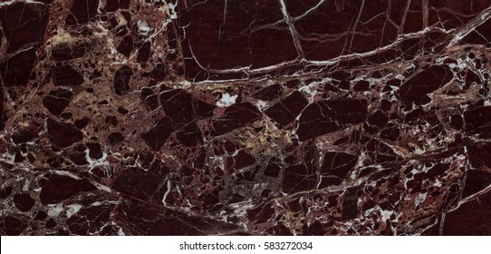 Polished slab of a natural Italian Rosso Levanto Vinous marble