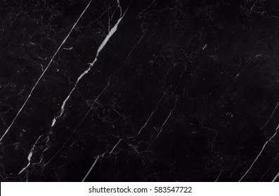 Polished slab of a natural spanish Nero Marquina black marble extracted from the region of Markina, Basque Country in the North of Spain.