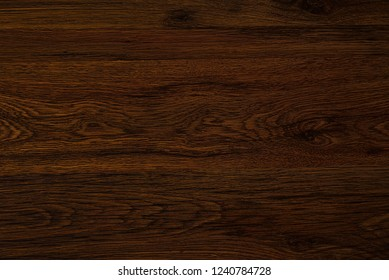 Polished wood texture. The background of polished wood texture. Texture-Dark-cherry