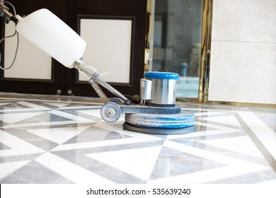 polisher working on marble floor in modern office building