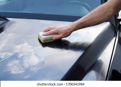 polishing a car by hand