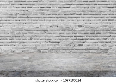 Polishing cement table top and background of old grey brick wall - can used for display or montage your products.