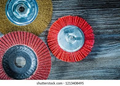 Polishing disc abrasive wire nylon brush on vintage wooden board.
