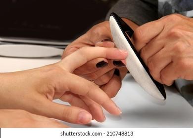 polishing nails during manicure process