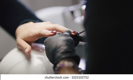 Polishing nails - professional manicure in beauty shop