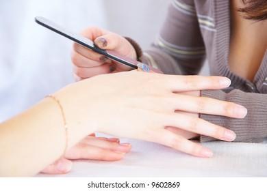 Polishing of a surface of a nail