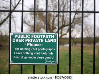 Polite warning sign asking people to show respect for the private land they are walking over on a public footpath in rural Gloucestershire, UK 'Take nothing but photographs...