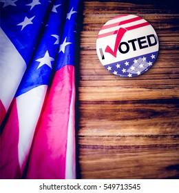 Political button against usa flag on table