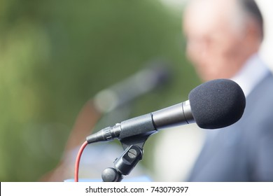 Political campaign. Press conference. Microphone. Speaker. Speech.