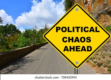 Political chaos ahead yellow warning street sign