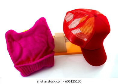 Political division and a divided country concept, illustrated by the pink hat representing the liberals and the red trucker hat representing the conservatives in an increasingly partisan America