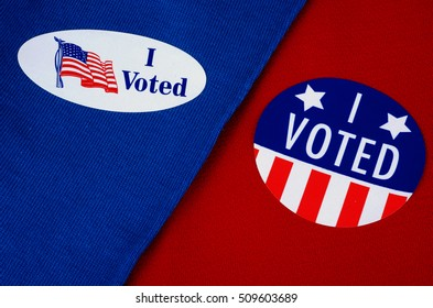 "Political ""I Voted"" Stickers On Red And Blue Material Divided In Half"