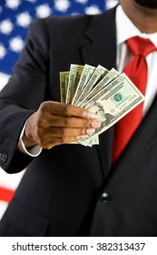 Politician: Holding Out Fan of Twenty Dollar Bills
