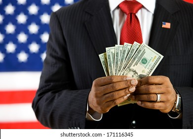Politician: Man Holding Fanned Out US Currency