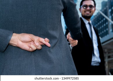 Politician shake hands together and holding another fingers crossed behind his back,Honesty isn't always,Here's when it might be better to lie,Dishonest businessman telling lies,Trickery Concept
