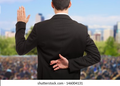 Politician swearing an oath with fingers crossed behind back