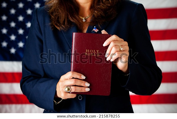 Politician: Woman Holding Up Religious Bible