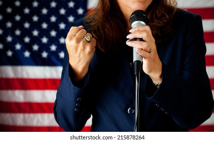 Politician: Woman Speaking Strongly At Microphone