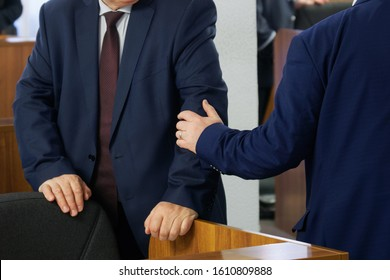 Politicians or businessmen greet each other before the start of a meeting or conference. Preparing for a decision. Head and subordinate. Patronage. Without a face