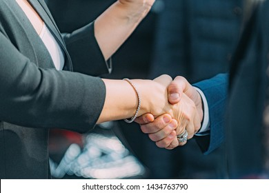 Politicians shaking hands. Female Politician shaking hands with male politician