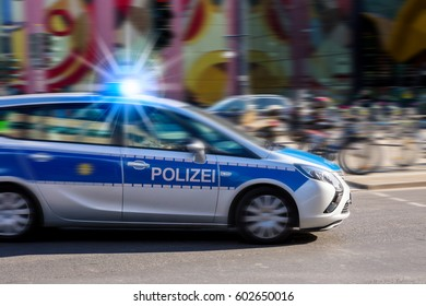 POLIZEI - POLICE ; a police car in action (Germany)