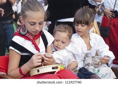 "POLIZZI GENEROSA, SICILY - AUGUST 19:children undefined from sicilian folk group at the International ""Festival of hazelnuts"": August 19, 2012 in Polizzi Generosa,Sicily, Italy"