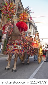"POLIZZI GENEROSA, SICILY - AUGUST 19:Folkloristic parade of traditional horse-cart in Sicily during the ""Festival of hazelnuts"",launch of hazelnuts: August 19, 2012 in Polizzi Generosa,Sicily, Italy"