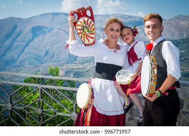 POLIZZI GENEROSA, SICILY-AUGUST 09 2015: Sicilian folk group at the Festival of hazelnuts, music and parade through the city in Polizzi Generosa, Sicily, Italy