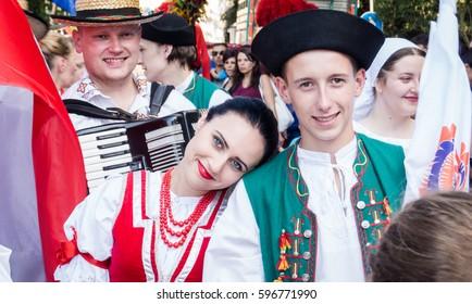 "POLIZZI GENEROSA, SICILY-AUGUST 09 2015: Polish folk couple at the ""Festival of hazelnuts"" music and parade through the city in Polizzi Generosa, Sicily, Italy"