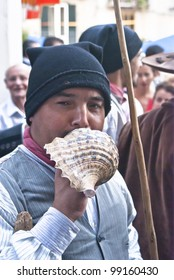 """POLIZZI GENEROSA,SICILY-AUGUST 21: Portuguese folk group plays a shell at the International """"Festival of hazelnuts"""", parade through the streets :August 21,2011 in Polizzi Generosa,Palermo,Sicily,Italy"""