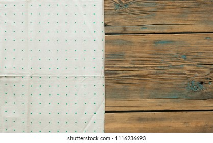polka dot tablecloth or towel over the surface of a brown wooden table