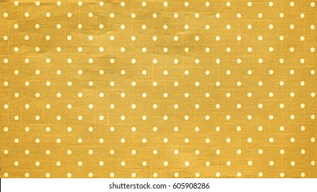 Polka dots pattern and yellow tone of cloth, Texture of silk fabric cotton, Wallpaper background