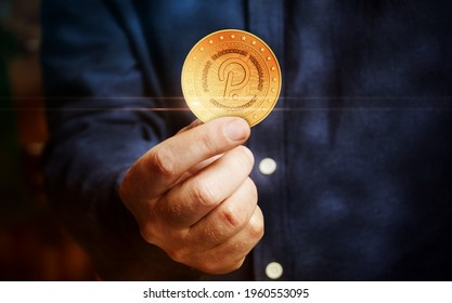 Polkadot cryptocurrency symbol golden coin in hand abstract concept.